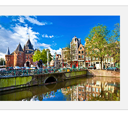 Fly R/T to Amsterdam
