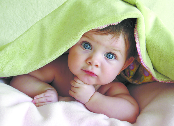 Baby-With-Blue-Eyes-Lying-Under-Blanket