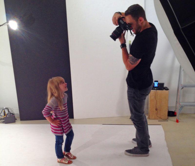 photographer-taking-photo-of-child
