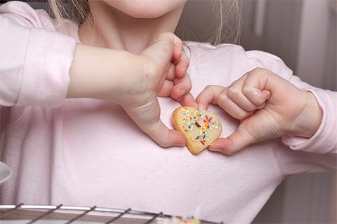 girl-holding-heart-cookie