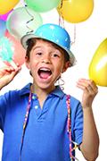 boy-in-birthday-hat-celebrating