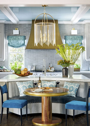 2016 house beautiful kitchen of the year banquette with round table aqua throw pillows