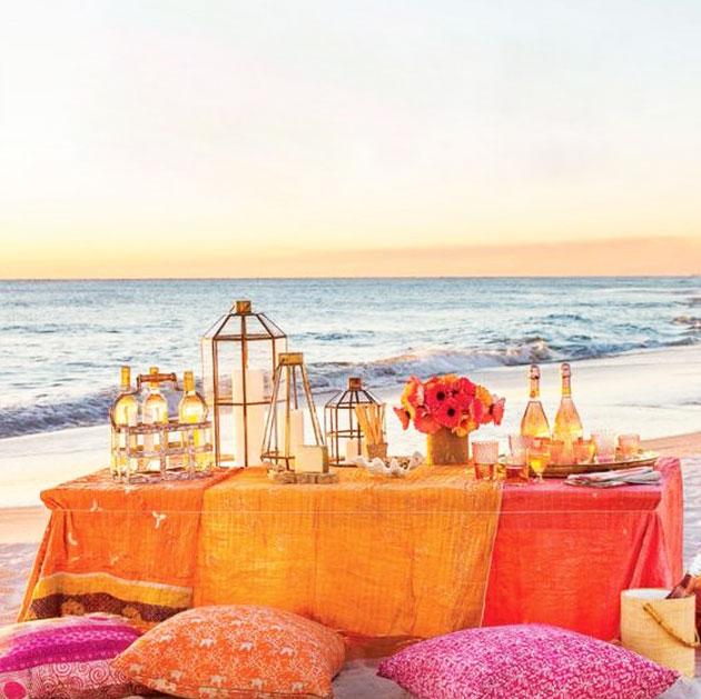 Beach dinner tablescape- zen beach dinner table setting orange pink colors for sunset beach dinner