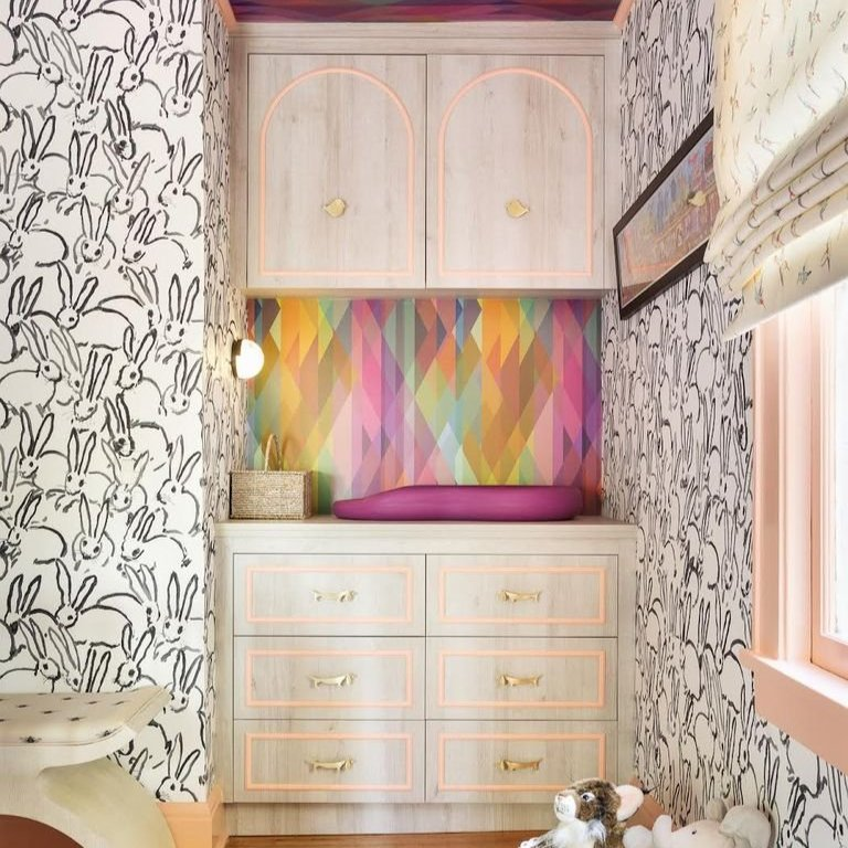 This Nursery Has a Custom Nook That Acts as Changing Table, Dresser, and Storage Unit in One