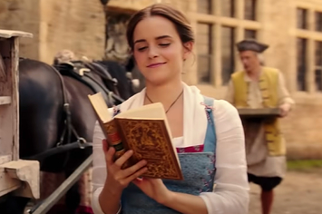 Film still from live-action ''Beauty and the Beast'' with Belle reading a book while walking
