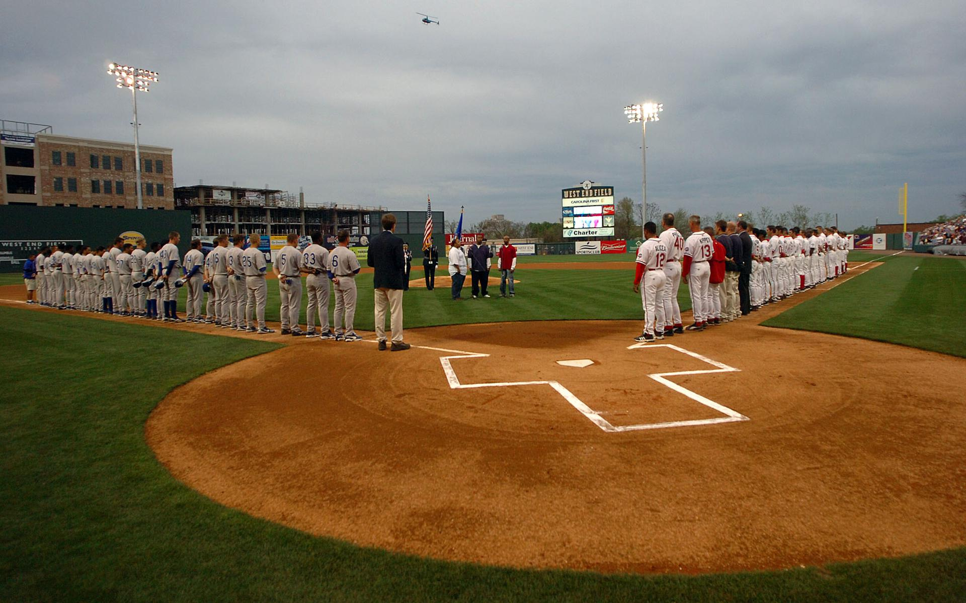 Both teams line the baseball diamond for the national anthem at the 2006 inaugural game