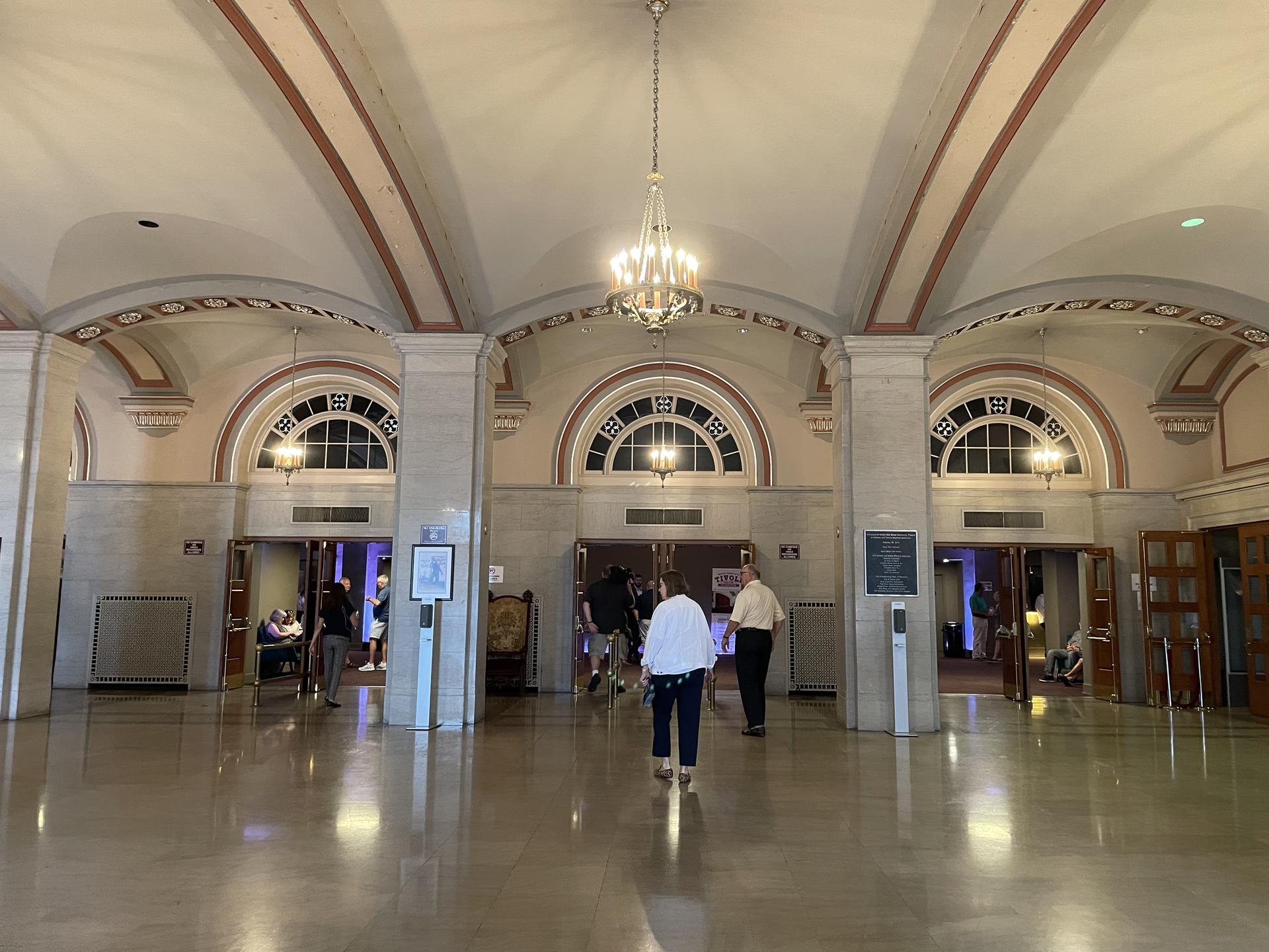Photo of the Soldiers & Sailors Memorial Auditorium atrium, with a grand chandelier and three main entryways.