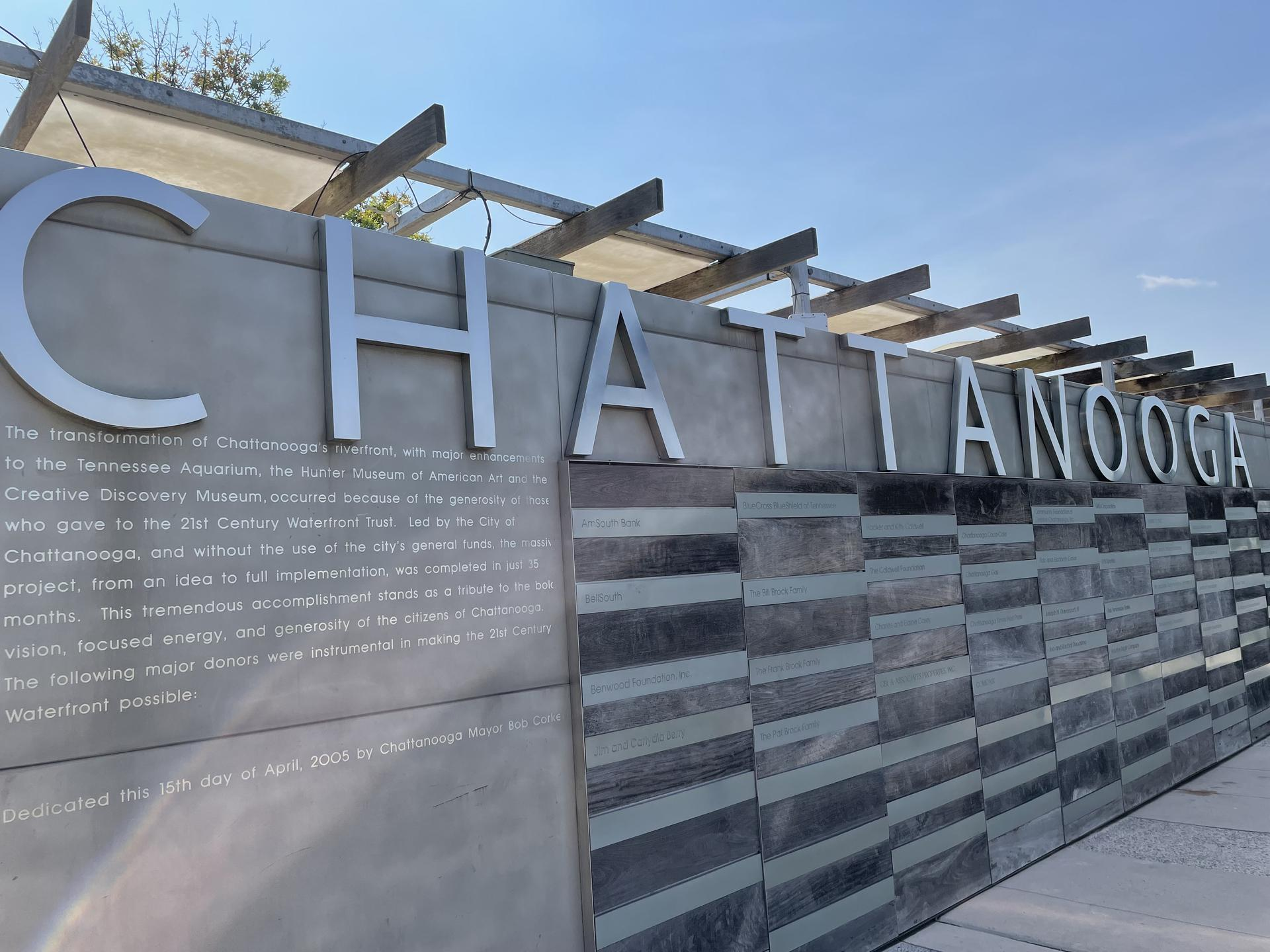 Photo of a large concrete slab with the word ''Chattanooga'' in large, silver letters sprawling across the slab.