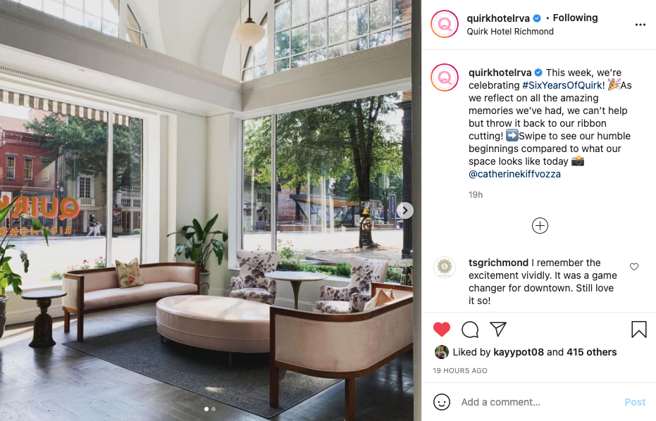 A screenshot of an Instagram post. The image is the interior of the Quirk hotel, with a view out the window of Broad Street. The caption says the hotel is celebrating 6 years of being open in the Arts District.