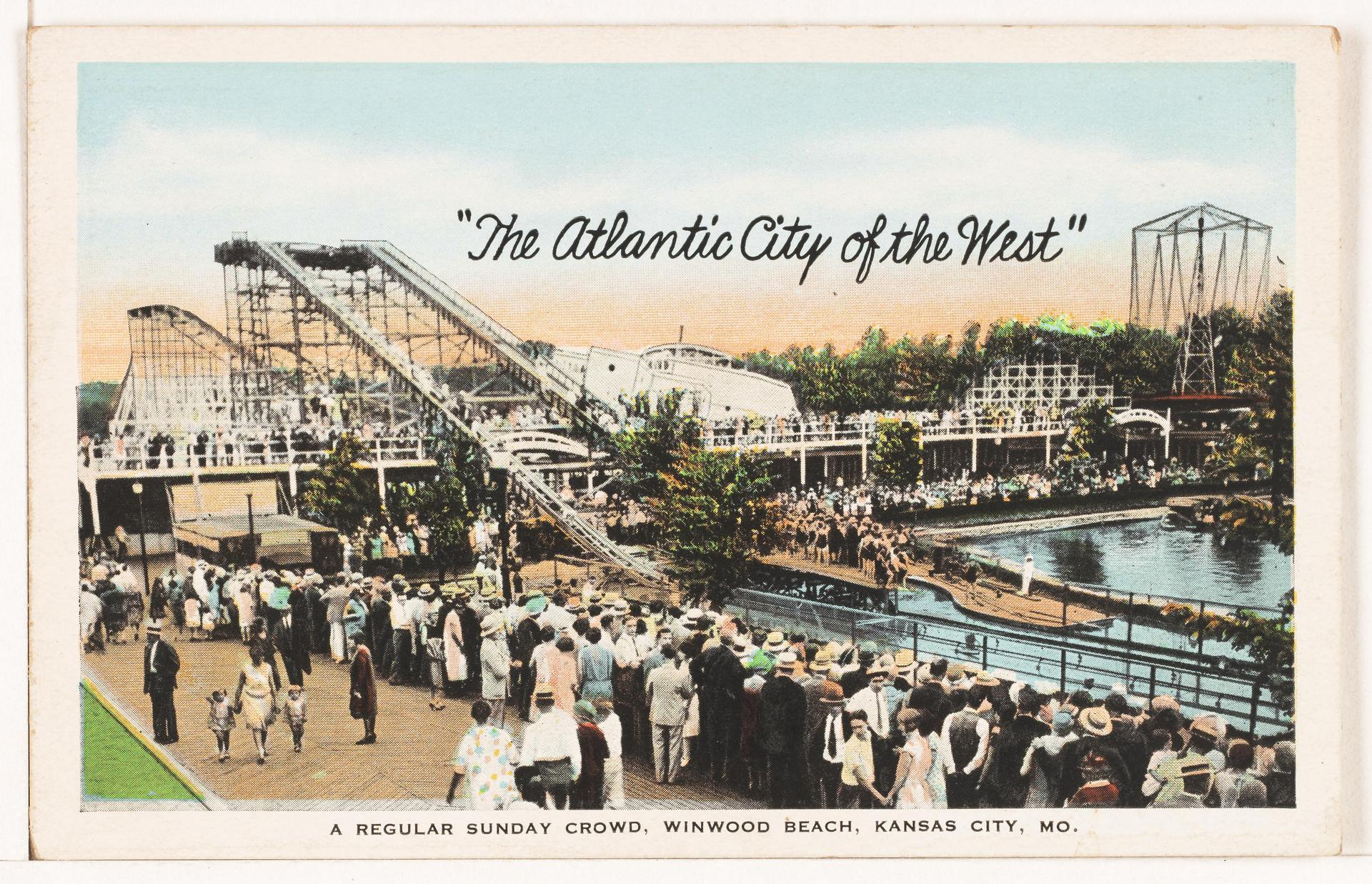 A snapshot of the lake at Winnwood Beach with views of the rides and and a Sunday crowd visiting.